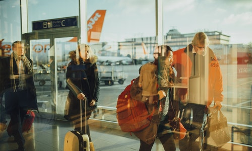 people-airport-international-travel-luggage-suitcases